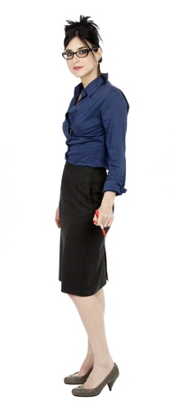 early 30s: An adult (early 30s) black haired caucasian woman, wearing a blue buttoned shirt, a dark gray skirt and holding a pen in her hand, looking at the camera with a calm and confident expression. Isolated on white background.