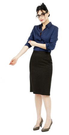 early 30s: An adult (early 30s) black haired caucasian woman, wearing a blue buttoned shirt and a dark gray skirt, looking at the camera with a somewhat timid expression and posture while handling her shirts sleeve. Isolated on white background.