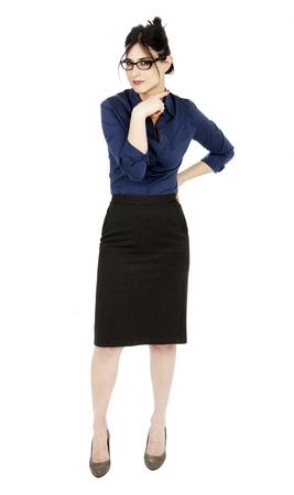 An adult (early 30's) black haired caucasian woman wearing a blue buttoned shirt and a dark gray skirt. She is gesturing a cutting motion on her throat, which comes to suggest a warning, or maybe even a threat. Isolated on white background. photo