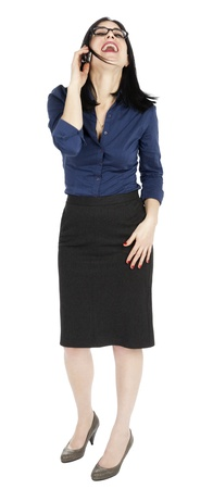 early 30s: An adult (early 30s) black haired caucasian woman, wearing a blue buttoned shirt and a dark gray skirt; her head tilted up, eyes closed and she is laughing her heart out on the phone. Isolated on white background.