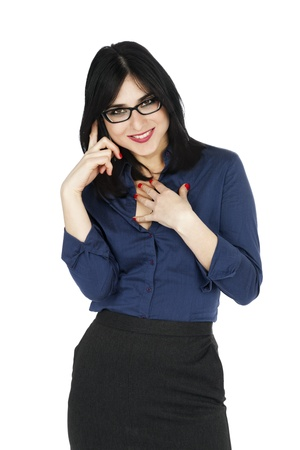 early 30s: An adult (early 30s) black haired caucasian woman, wearing a blue buttoned shirt and a dark gray skirt; smiling to the camera while on the phone. Isolated on white background.