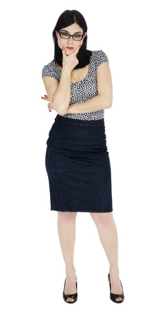 early 30s: An adult (early 30s) black haired caucasian woman, wearing a dotted shirt and a dark jeans skirt  looking at camera with a tough expression and posture. Isolated on white background. Stock Photo