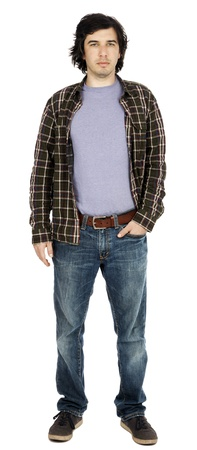 early 30s: Caucasian male in his early 30s dressed in a casual attire, looking at the camera with a serious expression, hand in pocket of his jeans. Stock Photo