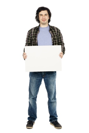 early 30s: Caucasian male in his early 30s dressed in a casual attire and holding a large blank white sign, looking at the camera ith a toothlessle. Isolated on white background.