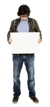 early 30s: Caucasian male in his early 30s dressed in a casual attire and holding a blank white sign and looking down at it. Isolated on white background.