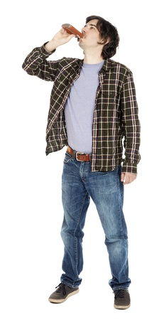 early 30s: A caucasian male in his early 30s dressed in a casual attire, tilting his head up and drinking from a hip flask. Isolated on white background.