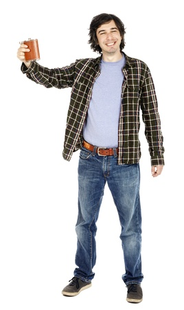 A caucasian male in his early 30s dressed in a casual attire,looking at the camera with utter mindless joy while lifting his hand holding a hip flask. Cheers! Isolated on white background. Stock Photo