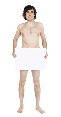 desnudo masculino: Vista de longitud completa de un hombre de raza cauc�sica de adultos en sus primeros 30 a�os mirando a la c�mara con una sonrisa y la celebraci�n de un signo que est� cubriendo sus parts.Is privadas se desnuda? Aislado sobre fondo blanco.