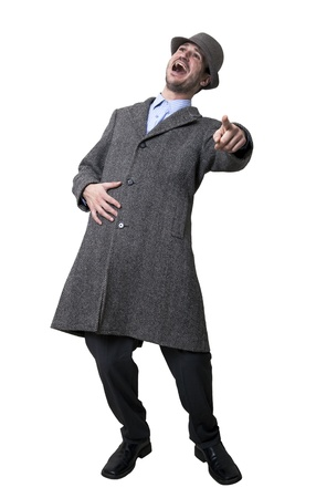 A person dressed in a gray overcoat and a gray hat laughing madly and looking up. Isolated on white background. photo