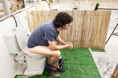 Taking A Dump Outdoors Stock Photo