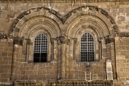 The windows above the entrance to the Church of the Holy Sepulchre in the old city of Jerusalem. This is the place where Jesus Christ was crucified, buried and resurrected, according to the Catholic belief.