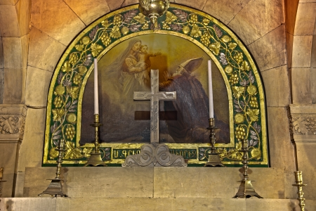 One of two altars in the Saint Helen Chapel in the Church of the Holy Sepulchre, in the old city of Jerusalem, Israel. HDR. Stock Photo