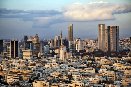 A view to the east, depicting the cityscape of downtown Tel-Aviv and its neighboring city Ramat-Gan at dusk. This is the central skyscraper area in the biggest metropolis in Israel. Stock Photo