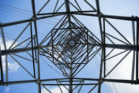 sofisticated: View at a high-voltage electricity pylon from directly below, which deconstructs the subject from its function and treats it as a mere sofisticated geometric abstract.