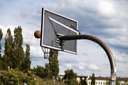 maybe: Behind-the-basket POV of a basketball just before (maybe) passing through the net. Shot at Mauerpark, Berlin, Germany. Stock Photo