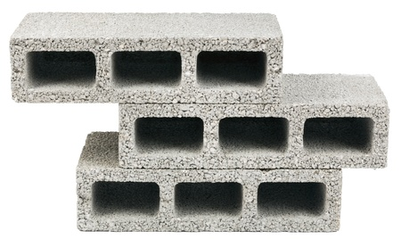 Three gray concrete construction blocks (a.k.a. cinder block, breeze block, cement block, foundation block, besser block; professional term: Concrete Masonary Unit - CMU) in a stack, isolated on white background.