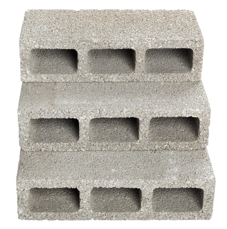 masonary: Three gray concrete construction blocks (a.k.a. cinder block, breeze block, cement block, foundation block, besser block; professional term: Concrete Masonary Unit - CMU) forming a flight of stairs. Isolated on white background.