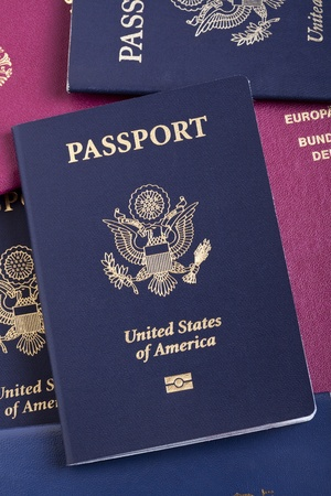 A USA passport resting on a stack of American and German passports. This is the new version of the passport, with the biometric chip (the old version of the passport is featured in some of the following photos). photo