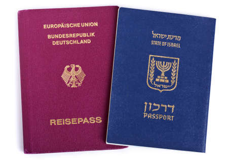 Israeli and German passports isolated on white background.  photo