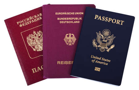 American, German and Russian passports isolated on white background. The USA passport has a biometric chip embeded in it. photo