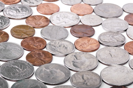 Various American coins (quarters, dimes, nickels, pennies) displayed on white background.  DEAR INSPECTOR: This is NOT an isolated on white image. photo