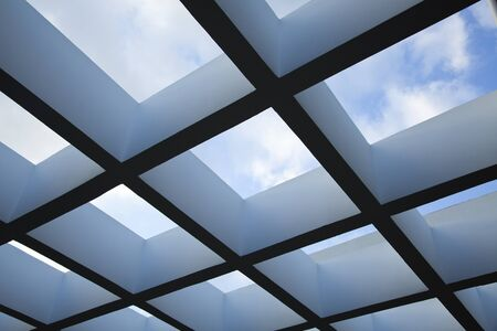 clody sky: Low angle shot of a patio pergola on the background of lovely clody sky.