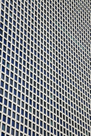 azrieli tower: A large amount of identical square windows of a skyscraper. Shot from a low angle with a slight tilt. Stock Photo