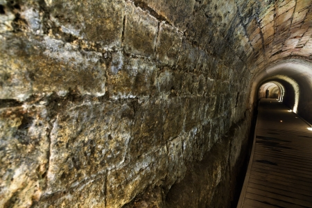 acre: The Templar tunnel in the old town of Acco, Israel. The Templar tunnel is an underground tunnel residing beneath the towns streets. The tunnel led from the Templar palace (which sunk into the sea in 1291) in the west to the sea port in the east.