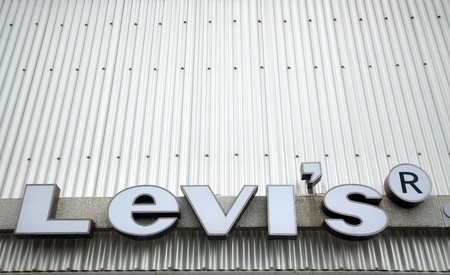 levi: Tel-Aviv, Israel - 10th, Marcj 2011: The Levis trademarked logo on the background of squiggly metal. Levis is a worldly known brand of denim jeans made by Levi Strauss & Co. since 1869. Editorial
