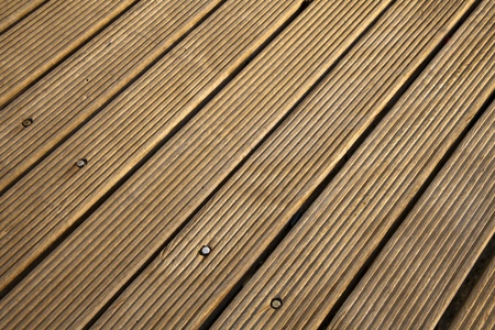 depicted: Sunlit wooden deck, depicted diagonally Stock Photo
