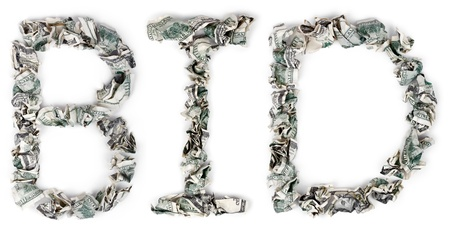 The word bid, made out of crimped 100$ bills. Isolated on white background. photo