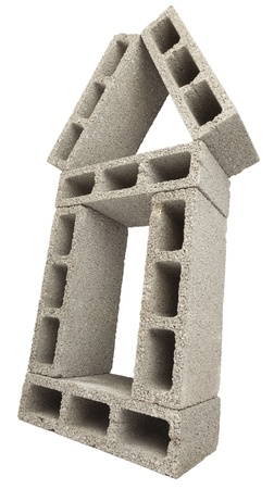 masonary: Low & wide angle view of gray concrete construction blocks (a.k.a. cinder block, breeze block, cement block, foundation block, besser block; professional term: Concrete Masonary Unit - CMU) put together in the shape of a house. Isolated on white backgroun
