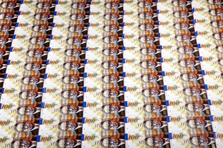 A high angle view of a very large amount of 100 NIS (New Israeli Shekel) money notes. Stock Photo - 19064190