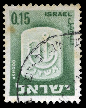 resides: A stamp from Israel, depicting the official symbol of the city of Ashdod. Ashdod. The largest sea port of Israel resides in Ashdod. Isolated on black background.  Stock Photo