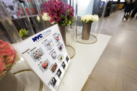 municipal editorial: New-York, USA - November 7th, 2012: Diminishing wide angle view of the flower bouquets presented for sale at the Marriage Bureaus public reception corridor. The office is located at the City Clerks building at 141 Worth street, Chinatown, Manhattan,
