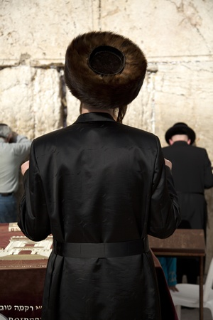 holy land: An orthodox Jewish young adult standing in prayerin front of the wailing wall in the old city of Jerusalem. Stock Photo