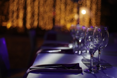 Wine glasses set on a dinner table at a wedding