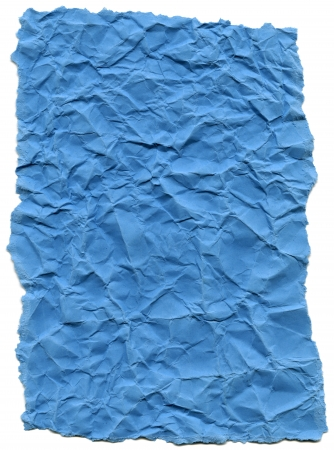Texture of baby blue crumpled fiber paper with torn edges, isolated on white background. photo
