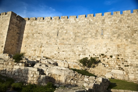 loophole: The surrounding wall of the old city of Jerusalem beneath a spectacular cloudy blue sky. Stock Photo