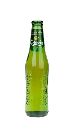 carlsberg: Tel-Aviv, Israel - 20th, March 2011: A 0.33 liter bottle of cold Carlsberg beer, isolated on white background.  Carlsberg is a pale lager (pilsner) beer that originates in Denmark, first brewed in 1904.