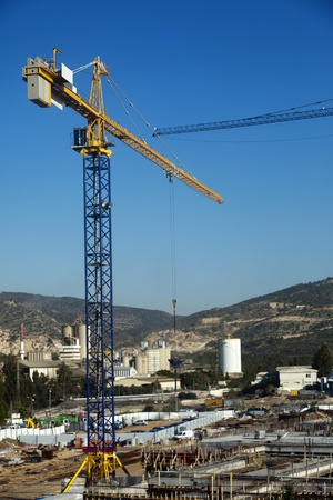 High   wide angle view of a shopping mall construction site surrounded by beautiful green hills scenery on a clear day  Stock Photo - 19066081