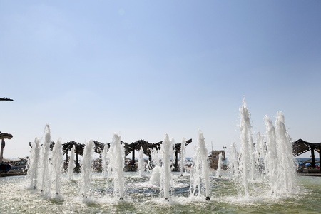 Tel-Aviv, Israel - August 18th, 2012: The fountain that seperates between Alenbi street and the beach (seen in the background) in Tel-Aviv.