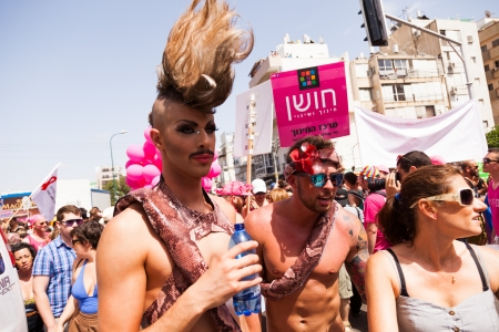 extrovert: Tel-Aviv, Israel - June 7, 2013: People partying at the annual gay parade in the streets of Tel-Aviv.