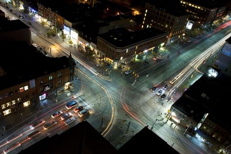 crossroads: Midnight traffic as seen from rooftop reverse