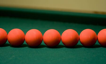 Multiple red pool balls photo