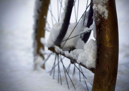 Rusted bike wheel in snow photo