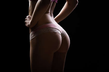 intracellular: Sexy woman in cotton underwear with perfect curves.Woman with perfect shape of beautiful thigh and bottom.Plastic surgery,healthy nutrition,fat lose,liposuction and cellulite removal concept