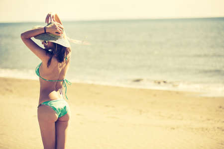 Summer beach fashion woman enjoying summer and sun.Concept of summer feeling,happiness.Fit and healthy summer body.Relaxed woman breathing fresh air,emotional sensual woman.Travel and vacation Banco de Imagens
