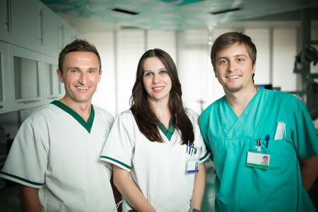 Young experienced doctors dentists standing along with nurse assistant.Team of doctors and nurse,good teamwork and positive work team spirit concept.Doctor and dentist in dental clinic.Dental center