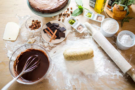 Cake making.Cookie dough..Preparations for making homemade chocolate.Mixed ingredients prepared for baking cake or bake.A whisk in a round bowl with liquid chocolate.Housewife making a chocolate cake Zdjęcie Seryjne
